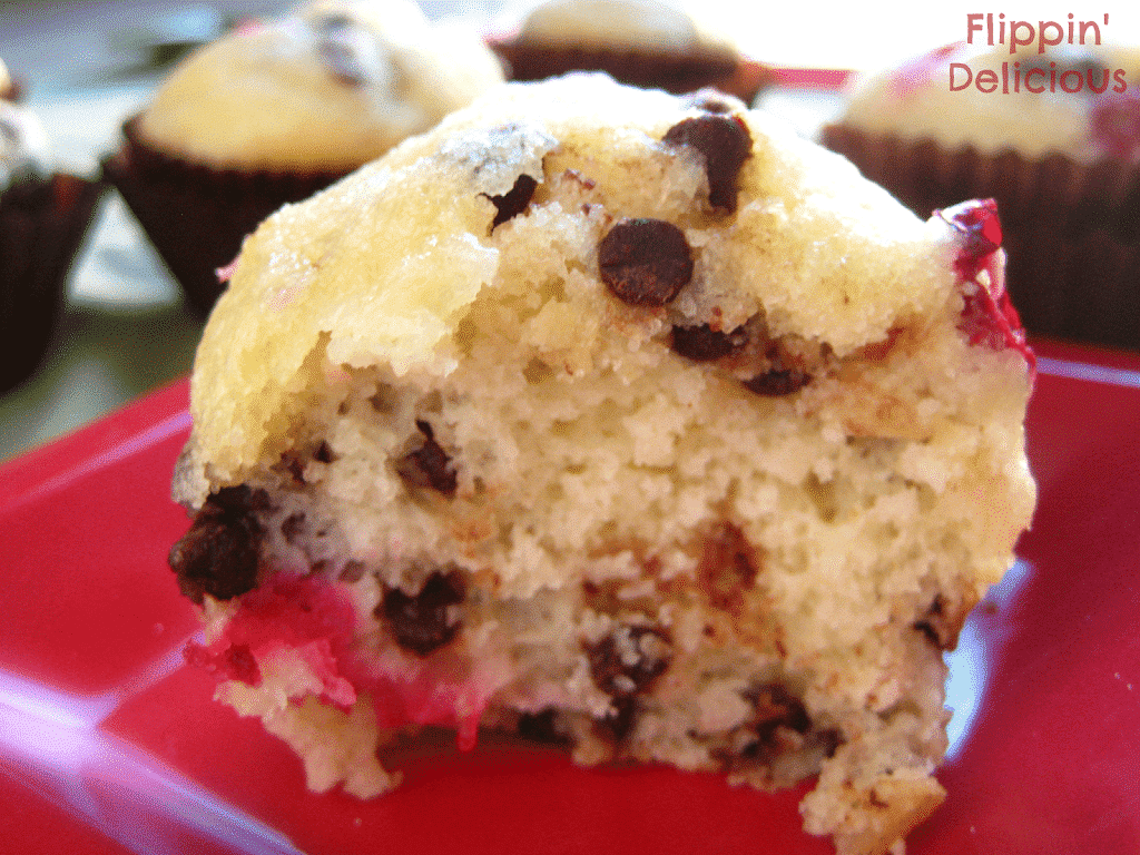 These gluten-free muffins are studded with halved cranberries and mini chocolate chips. Sprinkle the tops with just a touch of sugar for that added sparkle. www.flippindelicious.com