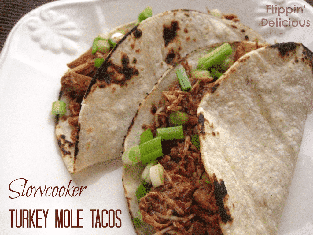 Gluten-Free Slowcooker Turkey Mole Tacos takes only 15 minutes to throw in the crockpot in the morning and then you can forget about it until dinner time. Full of flavor and just a little spice these tacos are great for when dinner time gets busy.