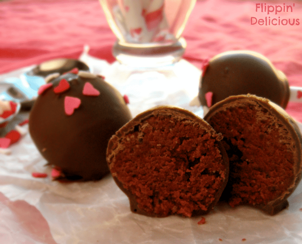 Gluten-free Red Velvet Cake Pops, made from the best cake ever. Sweet and moist red velvet cake enveloped in crunchy chocolate, and SPRINKLES! www.flippindelicious.com