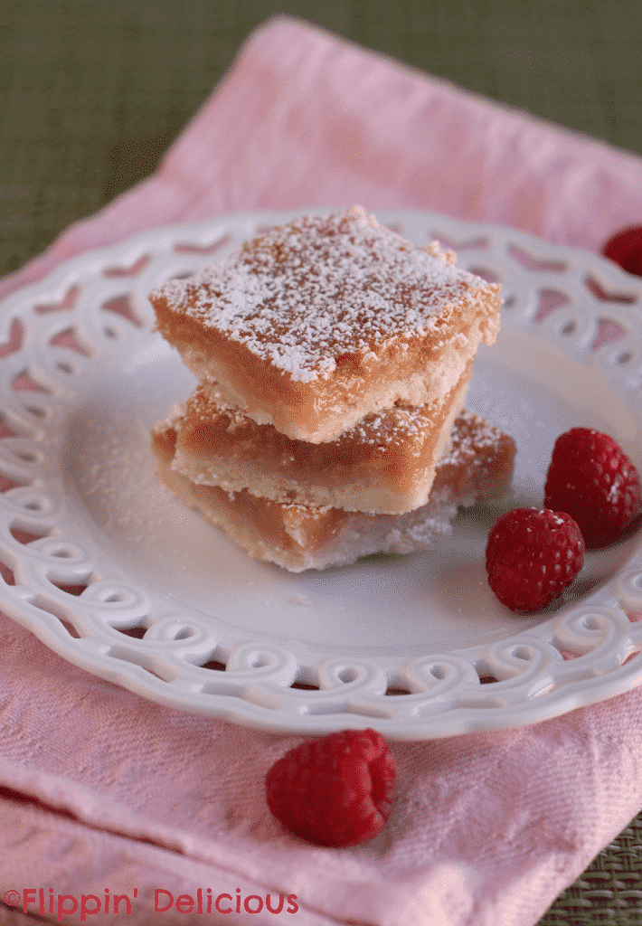Sweet and light gluten-free raspberry lemonade bars. I just love the sweet pink color of the curd in these bars. Each bite just tastes like summer!