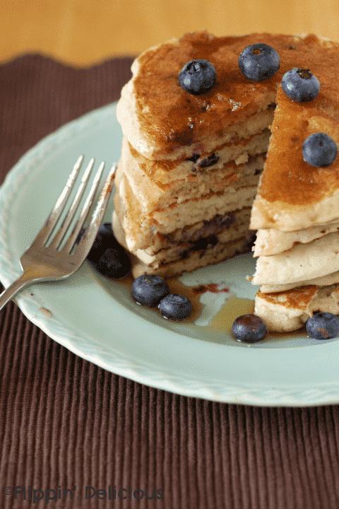 Sweet banana pancakes bursting with fresh blueberries. Best gluten-free breakfast around!